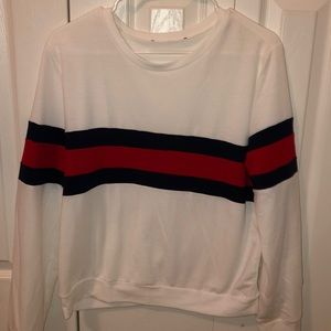 White sweater with blue and read stripes